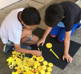 boys with yellow plastic